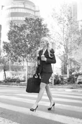 Woman Walking Across Street